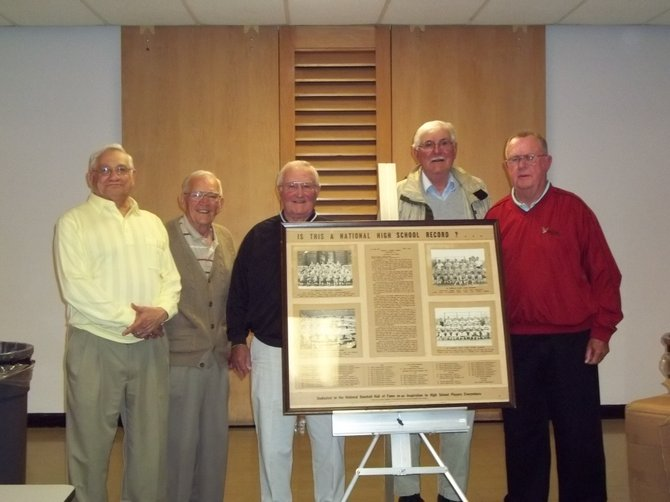 "(From left) Ken ""Ike "" Burton, Dick Perkins, Jack Montaque, Stuart Hosler and Jack Ecker stand around a plaque that formerly hung in the National Baseball Hall of Fame in Cooperstown. The plaque recognized 46-consecutive Onondaga County league wins from 1946 through 1950 for the Baldwinsville High School team, which the men played on. These men were inducted into the Baldwinsville Baseball Hall of Fame on June 1."