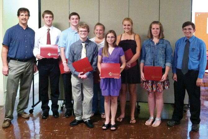 Baldwinsville Knights of Columbus Youth Awards Chairman Bill Rosentel, left, and Grand Knight John Christopher, right, stand with Catholic Youth Leadership Award Winners (second from left to right) James Wafful, Schuyler LaBeef, Ryan Peters, Jessica Testa, Hope Murphy, Meredith Starczewski and Emily Malone (award recipient Virginia Kamide is not pictured).