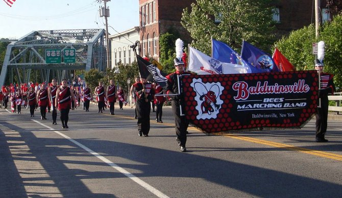 The Baldwinsville Marching Bees perform during the 2012 Memorial Day Parade in Baldwinsville. The Bees, along with the Baldwinsville Pep Band, will perform a free concert at 6:30 p.m. Tuesday, June 26, at Paper Mill Island to kick off the 2012 Free Summer Concert Series.