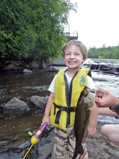 Exhibiting potential as a future Bass Angler of the Year, Chad Hagar of Saranac Lake smiles while admiring a fine largemouth he had just landed.