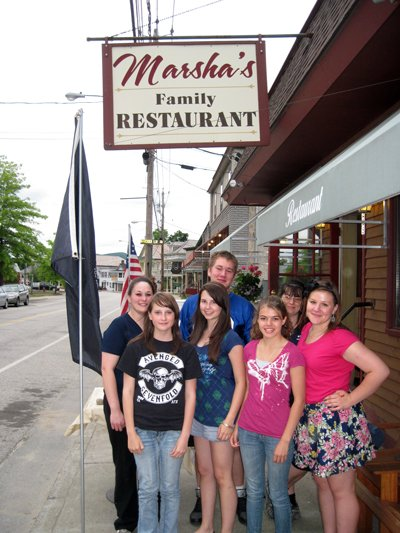 Here is a picture of Johnsburg Central School students at Marsha&#39;s Restaurant in North Creek volunteering at a Spaghetti Dinner to raise funds for the Johnsburg Dollars for Scholars Books for Young Scholars Program.