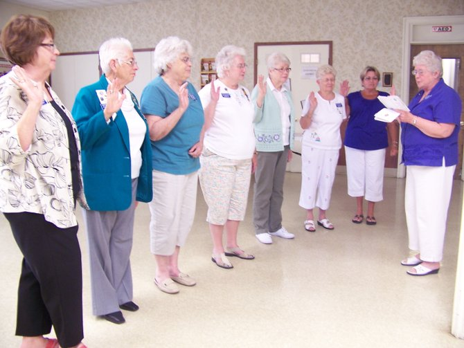 Chaplain of the Betsy Baldwin Chapter DAR Carole Menzel, right, swears in new officers of the chapter during the organization's June meeting. They are (from left) Jane Jacobs (regent), Loretta Thayer (first vice regent), Ann Deck (second vice regent), Kathleen Van Wie (treasurer), Joanne Sant (registrar), Joyce Wilkinson (historian) and Barbara Reeves (librarian).