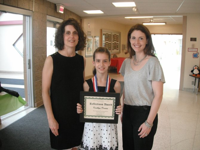 "Fifth grade Palmer Elementary student Kaitlyn Devine, center, has moved on to the state PTA Reflections competition with her literary submission for ""Diversity Means."" Pictured with Kaitlyn are her mother, Kathy Devine, and Kim Blasiak, Palmer PTA president."