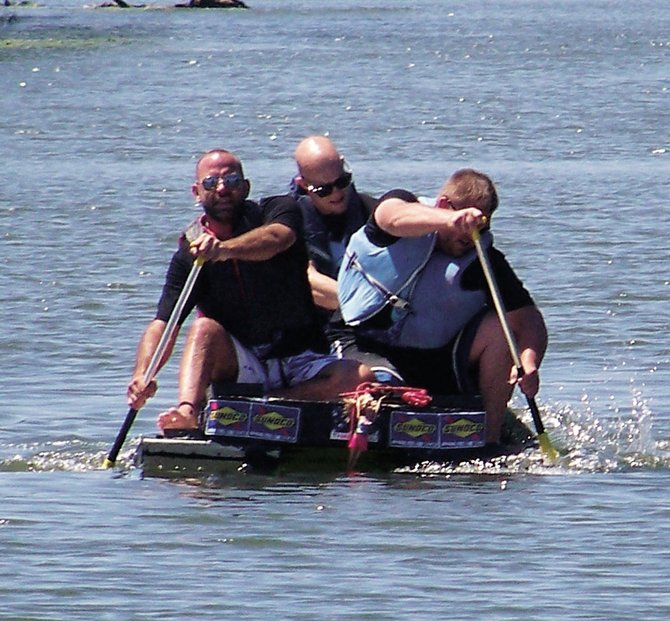 """Dave Roche, left, Matt Lail, center, and Nick Julian paddle their vessel Garage Sale during last year's Anything That Floats contest. The trio came in second place during the Seneca River Days event. First place went to Paper or Plastic, piloted by Edward Tucker, and third place went to SS Meathead, piloted by Steven Festenstein, who won the contest the year before. Other entries included We Thought The Prize Was $1,000, piloted by Becky Rotelli, Andy Rotelli, Stephanie Krause and Casey Romanick, and The White Pearl, piloted by brothers Ethan and Adam Pacheck. """"We sort of capsized as soon as we got in,"""" Adam said. """"At least the water was warm,"""" Ethan added."""