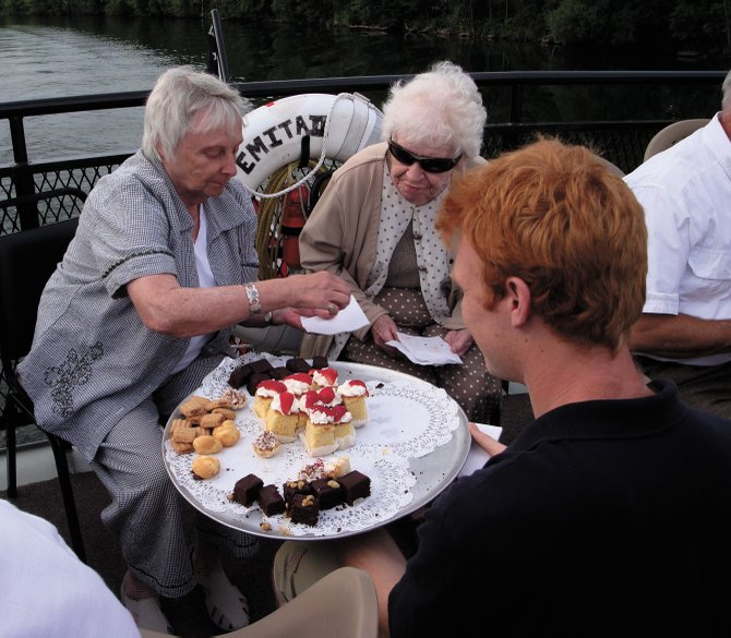 Jeff Hunt, a crew member on the vessel Emita II, serves desserts to guests during the Baldwinsville Public Library's second annual Seneca River Boat Cruise held July 7, 2011.