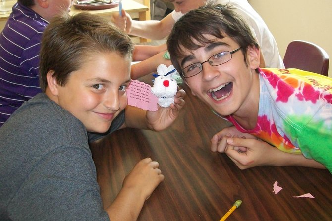 Ray Middle School Sixth-grader Jack Todora, left, holds a boo-boo bunny he created to donate to the Ronald McDonald House. With him is classmate Joshua Scholten.