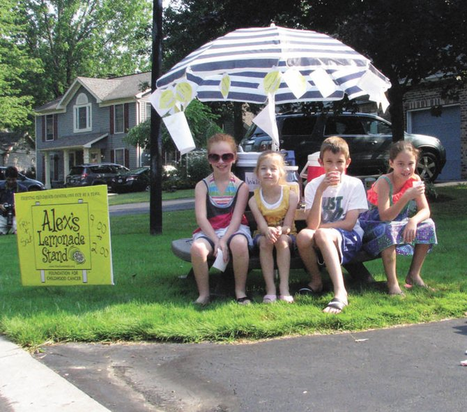 Three Cicero youths held a fundraiser for Alex's Lemonade Stand, a pediatric cancer charity, Friday and Saturday, raising more than $1,200. From left are Madison King, 8, Nadia Greco, 6, and Owen Greco, 8. Also pictured is Irina Schuldt, 9, also of Cicero.