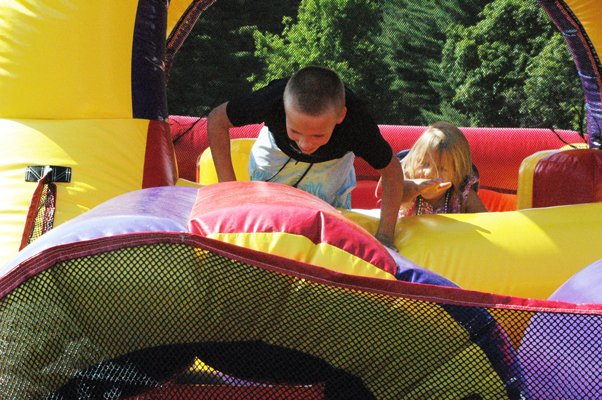 Kids play in a bounce house during Etown Day 2011.