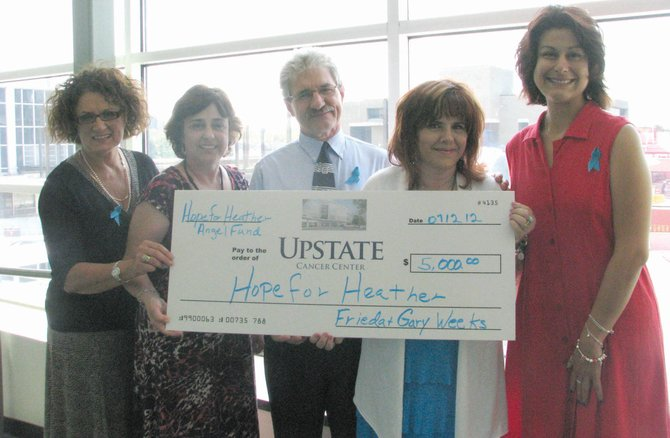 Hope for Heather recently presented a donation to Upstate University Hospital to start an Angel Fund to assist ovarian cancer patients with incidental expenses. Pictured from left are Toni Gary of Upstate, Terry Shenfield of Upstate, Gary and Frieda Weeks of Hope for Heather and Melissa Midgely.