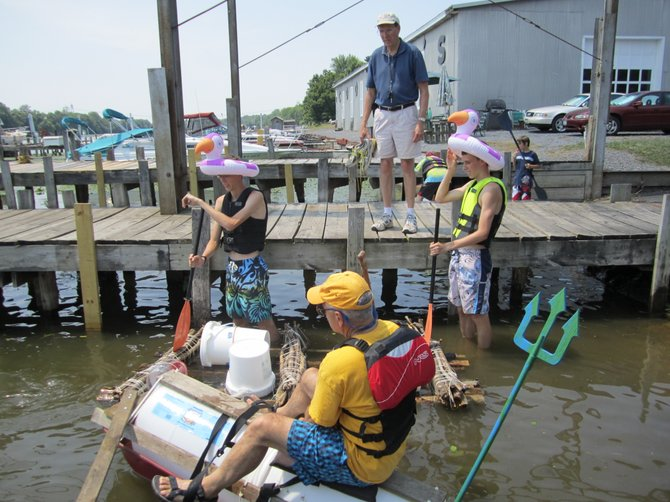 At the beginning of the 2012 Anything That Floats race, an anxious Gary Pachek watches as his sons' Adam and Ethan placed their almost-seaworthy vessel into the Seneca River at Cooper's Marina for the start of the race.