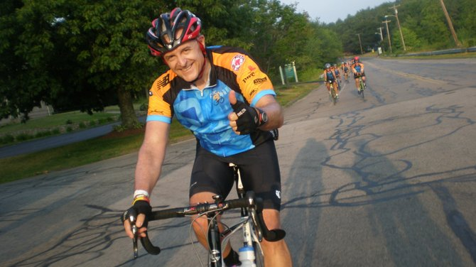 Chris Arnold, of Baldwinsville, gives a thumbs up while participating in the two-day, 190-mile bike ride, which is one of 11 routes in the Pan-Mass Challenge. Arnold will take the ride again this year on Aug. 4 and 5.