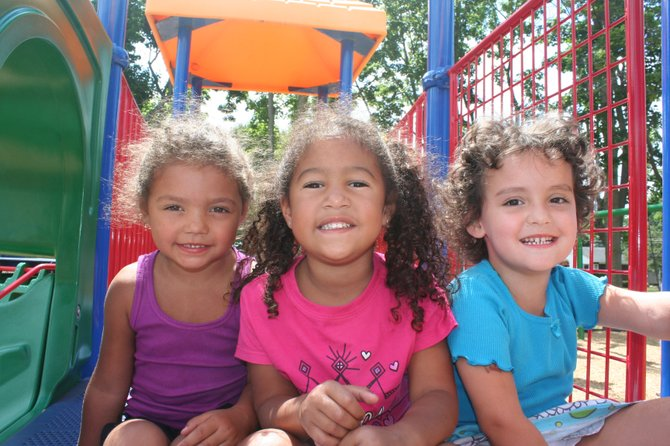 Children in Enable's newly renovated inclusive preschool program enjoy a sunny day on the playground.