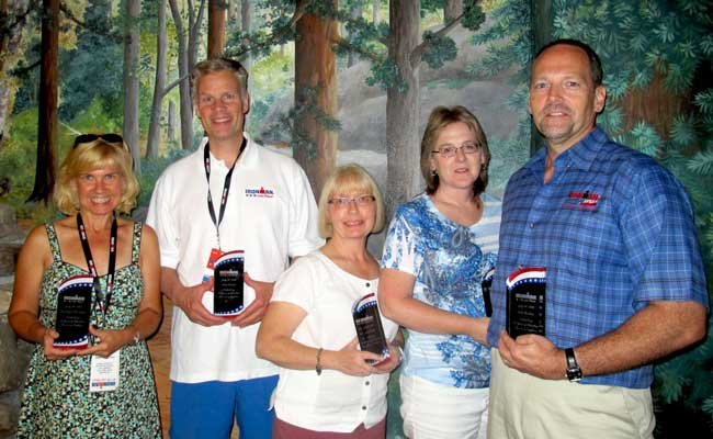Lee Ann Thomas, Jim Grant, Cora Clark, Patty Bashaw, Jeff Herter were recognized for 14 years as Ironman Lake Placid Volunteer Captains.