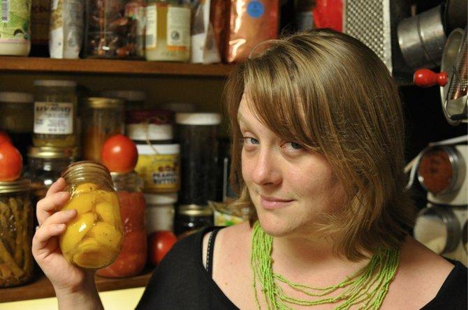 Marissa McClellan displays a jar of canned fruit.