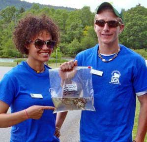 On their first day on duty lake stewards Sabina Sullivan, left, and Brandon Bezio removed two invasive species, curly-leaf pondweed and Eurasian watermilfoil, from a single boat launching at Mossy Point in Ticonderoga.