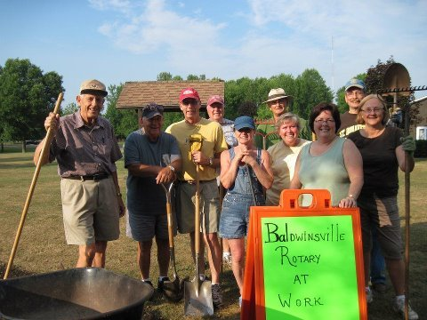 Rotarians (from left) Bob Bitz, Bill McAlee, Dean Johnson, Marv Joslyn (back), Dawn Custer, Mic Jenkins (back), Lynn Rosentel, Ann Smiley, Charlie Farrell and Janet Joslyn pose after completing work on a path to the Rotary Pavilion at Lysander Park. The Rotary Club would like to thank the Lysander Highway Department and Parks Department staff for preparing and installing the path.