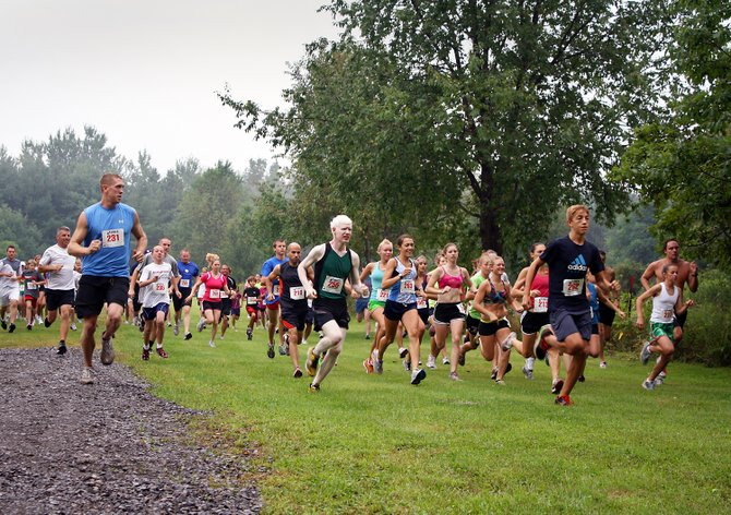 Participants take off for the 2011 Upstate Chiropractic 5K run held at Beaver Lake. This year's event returns Sunday, Aug. 19.
