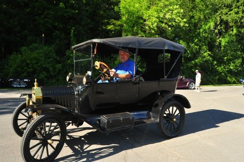 John Hudson pulls up to Canton Woods Senior Center in his 1915 Ford, which was awarded the Oldest of the Show during the 2012 Canton Woods Senior Center's annual car show held Monday, Aug. 6.