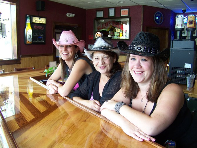 (From left) Amanda Miller, Cheryl Dombroski and Melissa Hennessey sport the cowgirl look at Timber Tavern Bar & Grill, a country-themed, full-service tavern located on the southern edge of Van Buren. Timber Tavern, formerly known as Kowalski's, has a hat stand full of cowboy hats that patrons can purchase to really get into the country fashion.