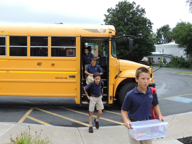 Connor Steria, right, followed by fellow St. Mary's Academy students (from left) Daniel Thorpe, Charlie Bridge and Luke Arvantides, arrive for their first day of school on Wednesday, Sept. 5.