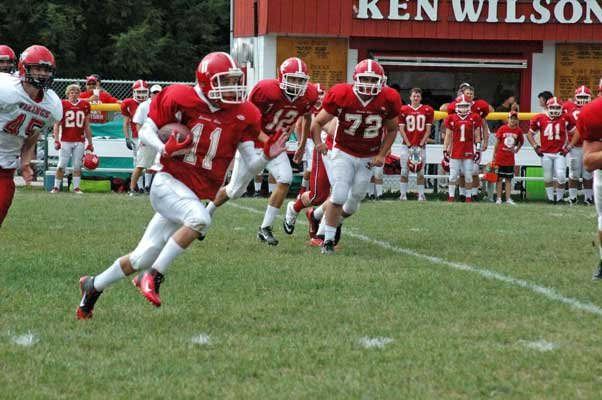 Dylan Gunther returns a punt for Saranac Lake as Kevin Morgan and grant Strack look to provide blocking.