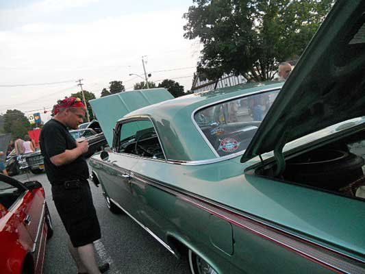 A visitor to a recent Car Show in Chestertown sponsored by the Panther Inn checks out Holly Palmer's 1962 Chevy Impala Super Sport 409. A follow-up car show in Chestertown, expected to host even more vintage vehicles, is set for Friday, Sept. 14.