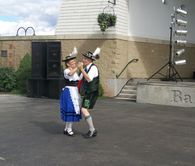 Enzian Bavarian German Dancers Karl Wuerslin, of Fayetteville, and Gracie Schell, of Utica, entertain the crowd with traditional German dancing during Saturday's Oktoberfest held on Paper Mill Island.