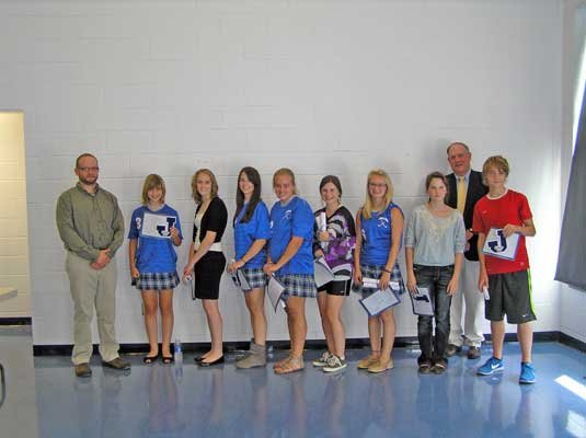 Students honored at the Scholarship J Assembly at Johnsburg Central School included, from left, science teacher Chad Pooler (JCS Teachers Association president), Angelina Conte, Shiloh Wood, Anna Liebelt, Colleen Fuller, Shannon Ovitt, Kayla Williford, Montana Berg, recently retired Coach Tim Leach (guest speaker) and Aidan Connelly.