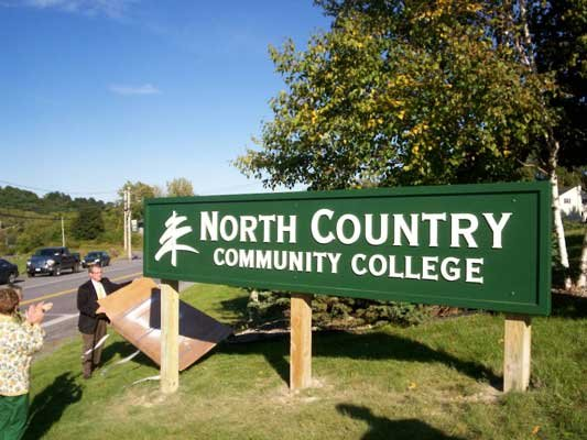 North Country Community College President Dr. Steve Tyrell unveils new sign at the Ticonderoga campus. The sign is designed to bring more awareness to the community about the presence of the college.