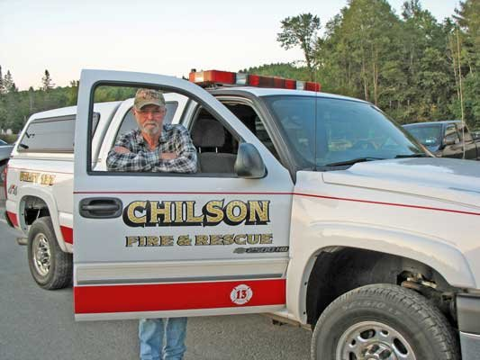 Chilson Volunteer Fire Department Board of Trustees Chairman Jim Davis stands with the department's newest vehicle, Utility 137.