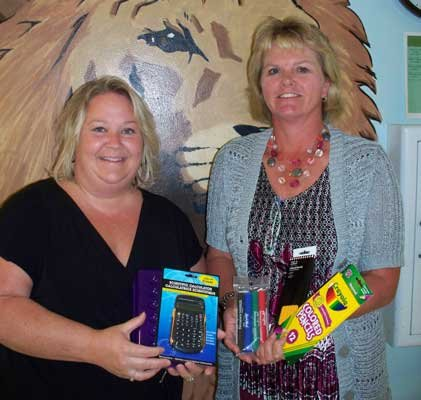 Wendy Courtright, TFCU Elizabethtown Branch Manager and Principal Cheryl Hutchins of Elizabethtown-Lewis Central School.