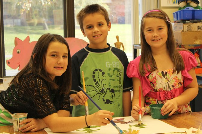 The artwork of (from left) Isabella Cartier, Colby Stables and Brianna Kennedy, students at Reynolds Elementary School, will be on display at the 93rd Annual New York State School Boards Association Conference in Rochester.