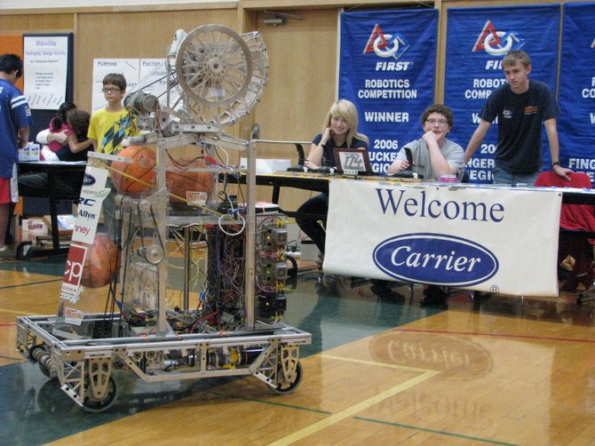 Snobot gets a workout during the 1st Annual STEM Day at Liverpool High School. Part of the team that created the machine includes senior Samantha Roberts, left, junior Tommy Williams, who worked on the robot's programming, and senior Jeff LaFlamme.