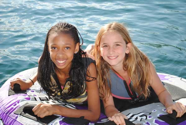 Ateira, left, and Chloe Derrico prepare for a wild ride of tubing on a nice summer day. The Derrico family of Ticonderoga is among the winners of The Fresh Air Fund's 2012 Photo Contest.