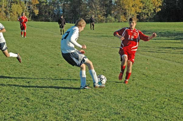 Tyrell Tryon of Westport looks to clear the ball away from Sam Politi of Willsboro. The Eagles were scheduled to start sectional play against Wells, while the Warriors will play in Elizabethtown-Lewis Oct. 26.