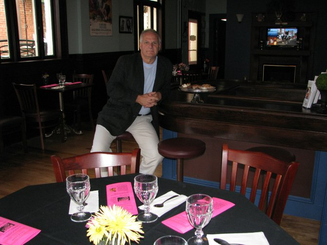 Local business owner Dennis Sick takes a moment to relax in La~La Land, the newest addition to the Mohegan Manor suite of eateries in downtown Baldwinsville. The patisserie housed Berndt-Michels Cleaners for more than 50 years before Sick purchased the space in June.