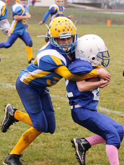 Burgher youth football action, grades 5-6.