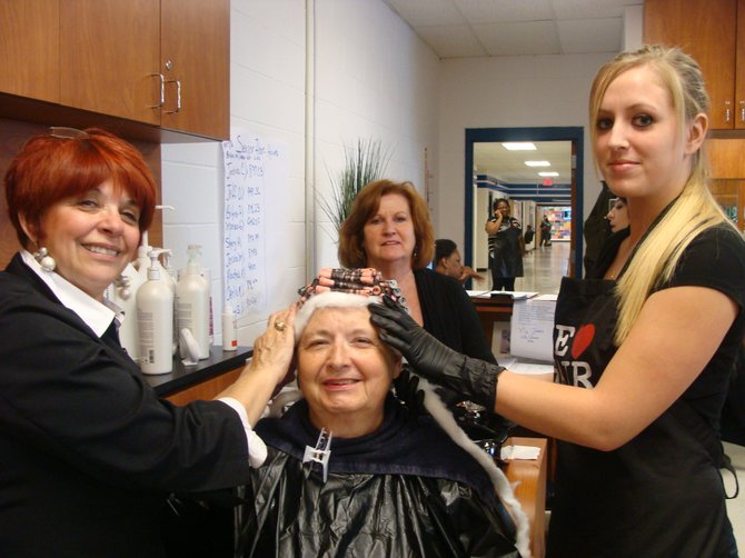 "Cosmetology instructors Cynthia Foran, left, and Sheila Lapsley, in back, check the work of graduating senior student Jessica Cleveland, of Syracuse, as she works on customer Mildred Flett of Baldwinsville. Flett noted that this was the second time she had come to BOCES to get her hair done and she ""will definitely come back."" Student Jessica Cleveland will graduate from the nine-month course Nov. 7."