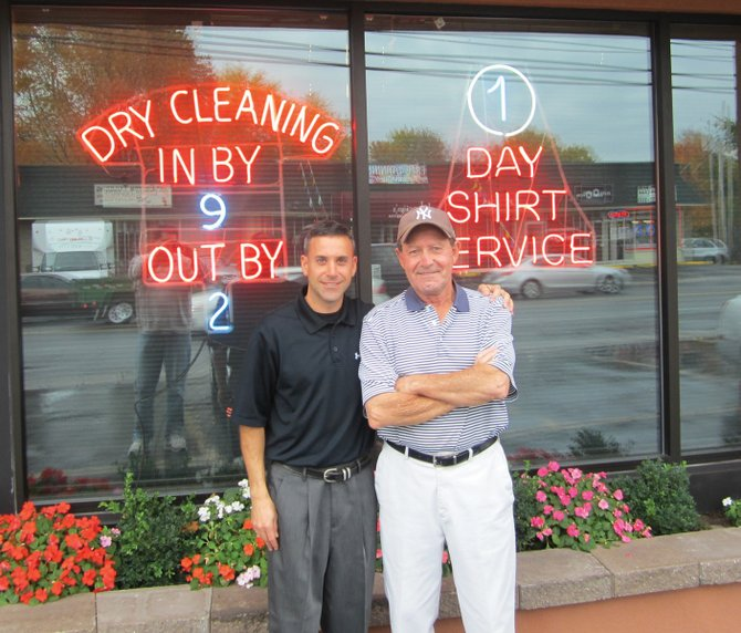 John Ritter Jr. poses with John Ritter Sr. outside Ritter's Cleaners in North Syracuse. The business marked its 40th anniversary on Oct. 13.