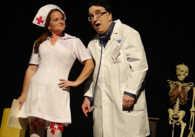 """In a rehearsal for the Vaudeville sketch """"The Doctor Will See you now,"""" Nurse McIntosh (Kate Hoy) tries to help Willie Clark as Dr. Klockenmeyer (John LaCasse). """"Mr Melnyk"""" is at the right."""