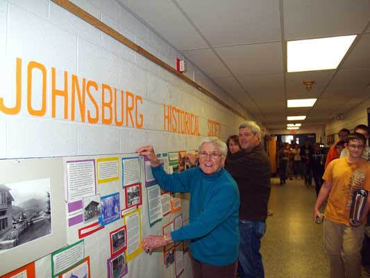 Members of Johnsburg Historical Society Sally Heidrich, David Braley and Kathy Maiorana (in background) installed an exhibit of the history of the Town of Johnsburg recently at Johnsburg Central School. The exhibit will be displayed until Spring 2013.