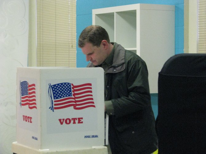 Democratic Congressional candidate Dan Maffei fills out his paper ballot at the DeWitt Community Church Tuesday morning. Maffei is running for the 24th District seat.