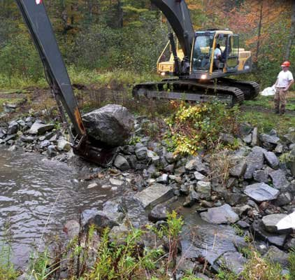 A sediment pond on Hague Brook is cleaned out as part of a joint project between the Lake George Association, the Warren County Soil and Water Conservation District, the town of Hague and the town of Bolton.