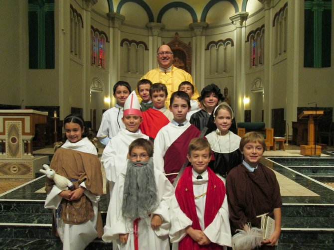 St. Mary's Academy fourth grade students dress up as a saint during a lesson in Mrs. Sandra Vinette's class in which the students researched saints and dressed up for a special Mass on all Saint's Day, Nov. 1.  Among the many Saints were the newly canonized St. Mariann Cope and St. Kateri Tekakwitha.