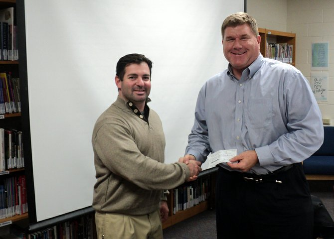 Baldwinsville Kiwanis Tony Saraceni (left) presents a $1,000 check to the Baldwinsville Baseball Booster president Jim Carson on Nov. 5. Dedicated to helping the youth and youth programs in the Baldwinsville area, the Baldwinsville Kiwanis donated the funds to help the high school baseball program from modified through varsity with their funding efforts. The 44th annual Turkey Day Race, the Baldwinsville Kiwanis' major fundraiser, returns this year on Thanksgiving Day. Stay tuned for more information about the race.