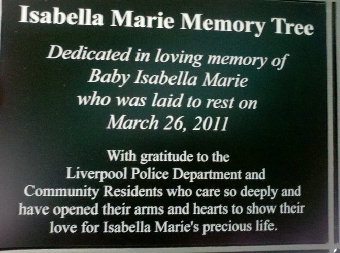 Manlius resident Laurie Venditti donated a tree in the shape of a teardrop in memory of Baby Isabella, which sits outside Liverpool Village Hall. Beneath the tree is this plaque.