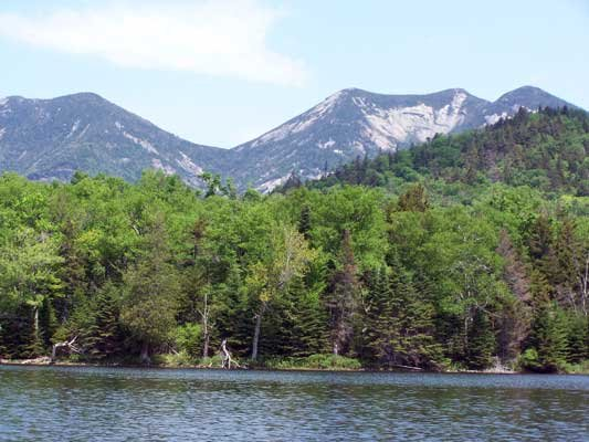 Soaring mountain cliffs and gentle backcountry lakes are key features of the rugged Adirondack wilderness.