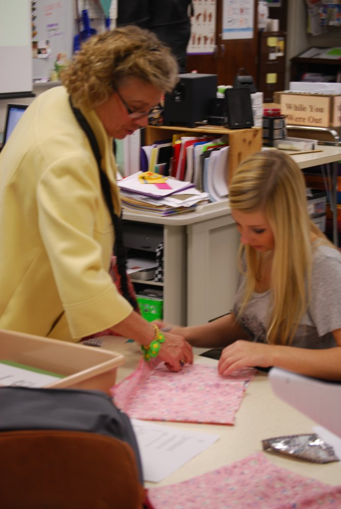 Shirley Ware works with Cicero 10th-grader Sydney Wright in her Family and Consumer Sciences classroom. Ware has been selected New York State Family and Consumer Sciences Teacher of the Year.