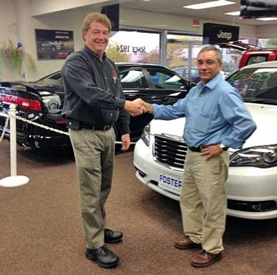 Joe Bodette, right, is welcomed by Dave Foster of Foster Motors in Middlebury, Vt. Bodette is the former owner of Frenchman's Restaurant in Crown Point.