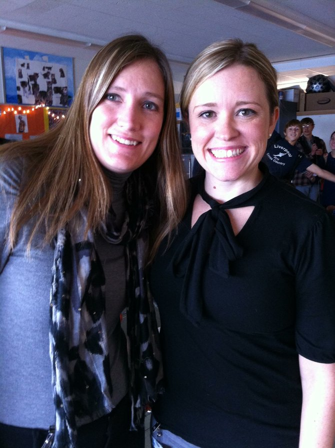 Jen Olden and Shannon Lasher, the organizers of Adopt-a-Family at Liverpool High School.